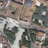 A L'Aquila un parcheggio sotto la collina  su cui sorge la Basilica rinascimentale